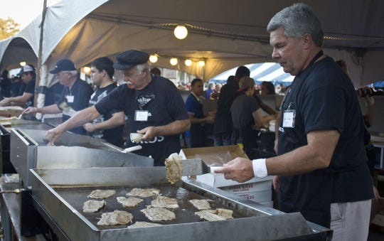 Volunteer Mike Wernker, works the grill at Greek Food Festival  in 2014.