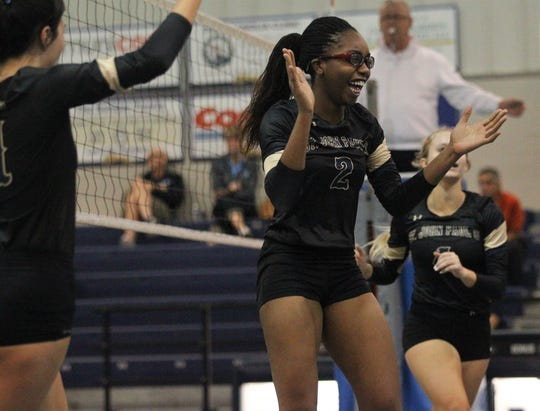Nina Ijeoma celebrates a point as the St. John Paul II volleyball team won a 3-0 regional semifinal match against St. Johns Country Day.