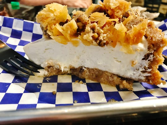 With Think Greek's baklava cheesecake, the house made baklava (a pastry of honey, nuts and phyllo dough), is used as a crust for a light, creamy cheesecake filling then topped with chopped baklava.