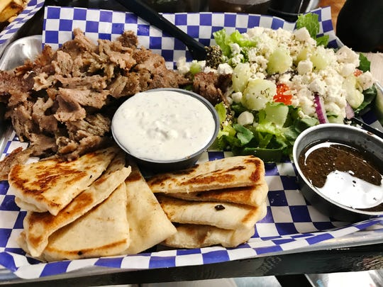 Think Greek's Lamb Gyro Platter with a  Greek salad.