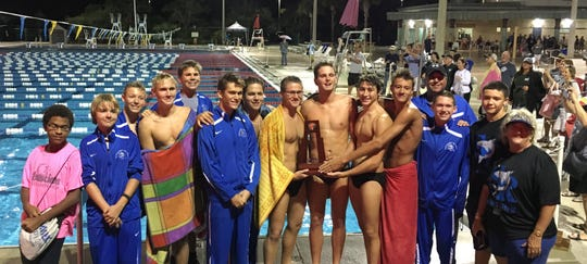 Sebastan River's boys swimming team won the District 5-3A title Wednesday in Sebastian. Team members (from left) include Matthew Smith, Bobby Sharkey, Mikey Hill, Reade Lawson, Cody Hatton, Dustin Lefebure, Gabe Knox, Derek Ledford, Ethan McCloud, Patrick Prescott, Ty Domster, coach Scott Barlow, Joey Twomey, Anvar Ashropov and coach Robin Carroll.