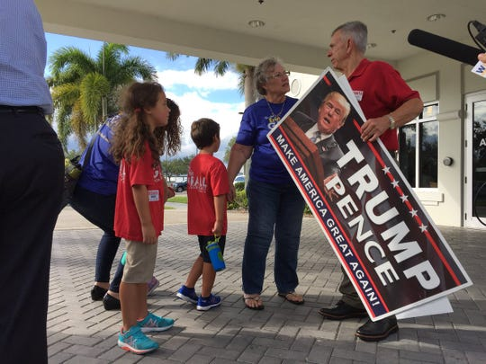 Local Republicans gather ahead of Vice President Mike Pence's arrival at Vero Beach Regional Airport on Tuesday, Oct. 25, 2018. The vice president was to attend a fundraiser at John's Island for Gov. Rick Scott.