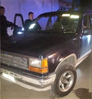 Chihuahua state police found two assault rifles in vehicle following an Oct. 19 shooting that wounded two officers outside state police headquarters in Juarez, Mexico.