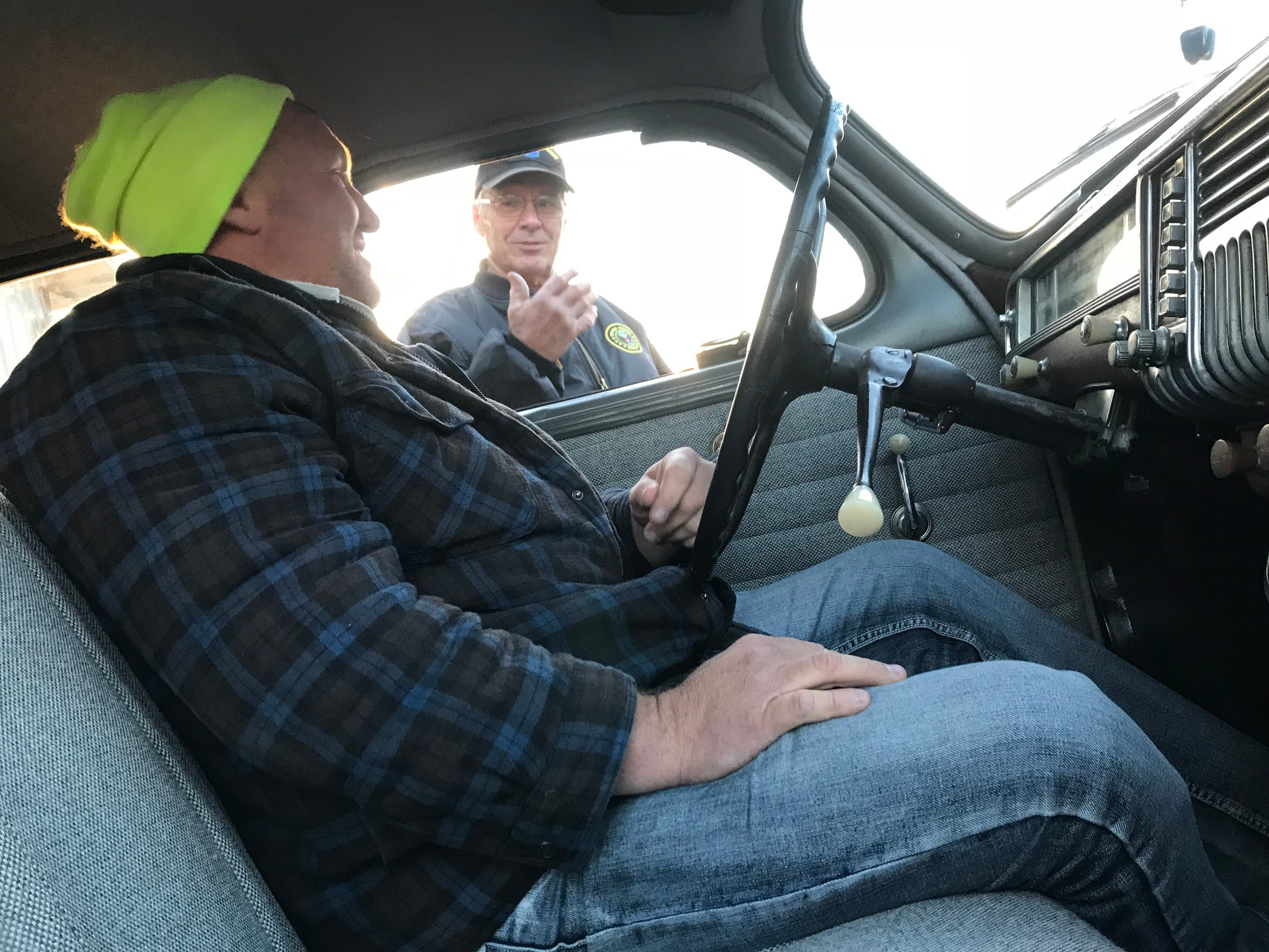 Tim Dupee, sitting behind the wheel, and Dale Lindwall talk about the special feeling they get from the 1948 Plymouth. Lindwall restored the sedan; Dupee now owns it.