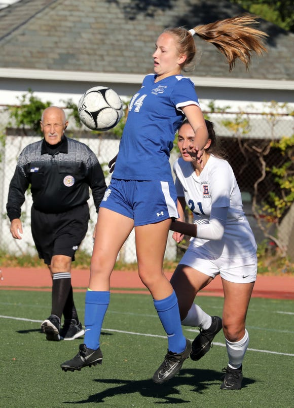 Bronxville's Rachael Peacock controls the ball in front of Briarcliff's Maya Celaj during their Section 1 Class B girls soccer semifinal at Bronxville Oct. 25, 2018. Bronxville won 2-1.