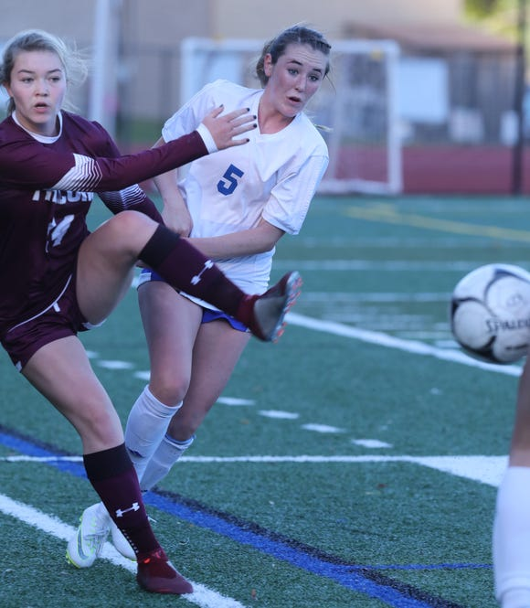 Pearl River's Kylie McNally (5) and Lily Winters (14) of Albertus Magnus battle for control of the ball during Section 1 Class A girls soccer semifinals at Albertus Magnus High School in Bardonia on Oct. 25, 2018. Pearl River defeats Albertus Magnus 1-0.