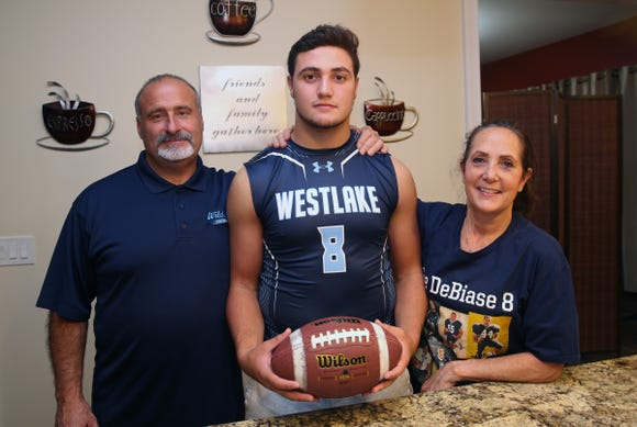 Westlake running back Andrew DeBiase with his parents Gary and Kathy in the kitchen at their Thornwood home Oct. 24, 2018.