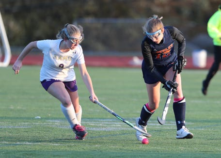 Horace Greeley's Olivia Barlow (12) fights for possession against Clarkstown North's Caroline Stevens (9) during their 4-1 win over Clarkstown North in the Class 'A' field hockey semifinal game at Clarkstown North High School in New City on Thursday, October 25, 2018.