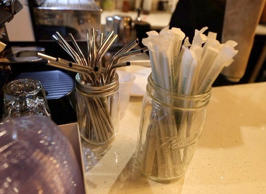 Reusable straws as well as straws made from biodegradable materials on the counter at First Village Coffee in Ossining Oct. 25, 2018. The coffee shop uses cups and straws made of biodegradable materials for all their drinks. They also offer metal reusable straws for patrons who are having their drinks in the shop. In addition, they sell the reusable straws. The coffee shop plans on ceasing the use of all straws by 2019.