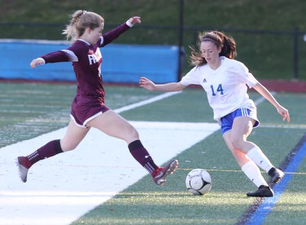 Pearl River's Sidney Zweibach (14) and Lily Winters (14) of Albertus Magnus battle for control of the ball during Section 1 Class A girls soccer semifinals at Albertus Magnus High School in Bardonia on Oct. 25, 2018. Pearl River defeats Albertus Magnus 1-0.