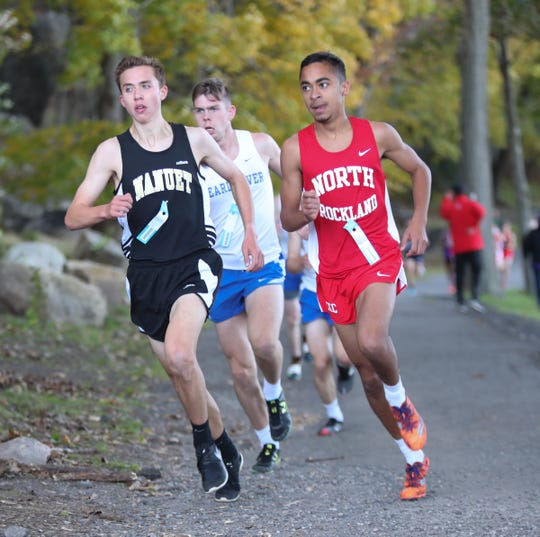 Nanuet's Ryan Guerci, left, with North Rockland's Dan Shephard, compete at the Rockland County Cross Country Championships at Bear Mountain State Park on Oct. 25.