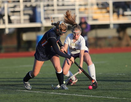 Horace Greeley's Lily Schoonmaker (9) and Clarkstown North's Caroline Stevens (9)  during their 4-1 win over Clarkstown North in the Class 'A' field hockey semifinal game at Clarkstown North High School in New City on Thursday, October 25, 2018.