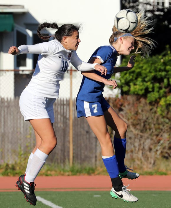 Bronxville's Kiki Tormey, right heads the ball under pressure from Briarcliff's Gabriella Volpacchio during their Section 1 Class B girls soccer semifinal at Bronxville Oct. 25, 2018. Bronxville won 2-1.