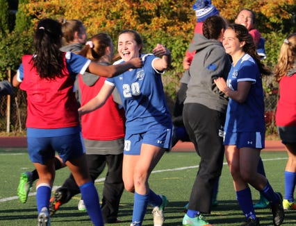 Bronxville players celebrate their 2-1 win over Briarcliff in their Section 1 Class B girls soccer semifinal at Bronxville Oct. 25, 2018.