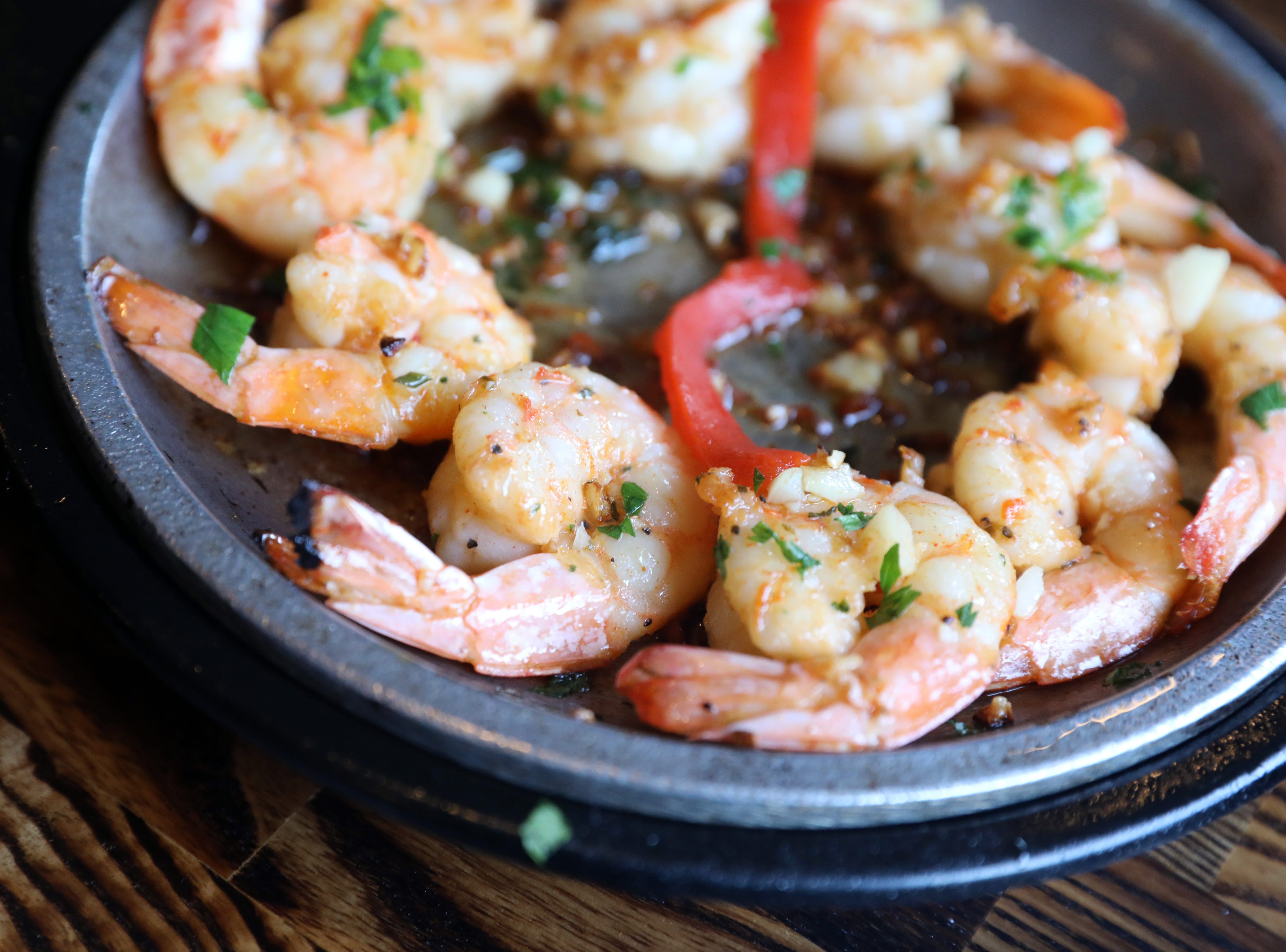 Gambas a la Plancha, Spanish marinated sizzling grilled shrimp at Basque Tapas Bar Restaurant in Piermont Oct. 23, 2018.