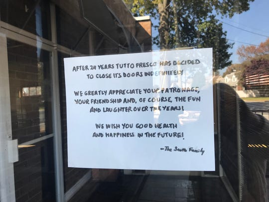 """A sign on the front door of Tutto Fresco restaurant in Penny Hill says the restaurant has closed """"indefinitely."""""""