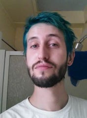 Joel Davis dyed his hair teal after his mother died from cervical cancer.