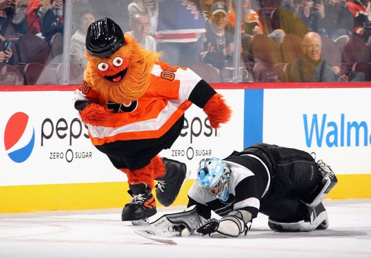 The Philadelphia Flyers mascot Gritty skates between periods of the game against the New York Rangers at the Wells Fargo Center on Sept. 27, 2018, in Philadelphia.