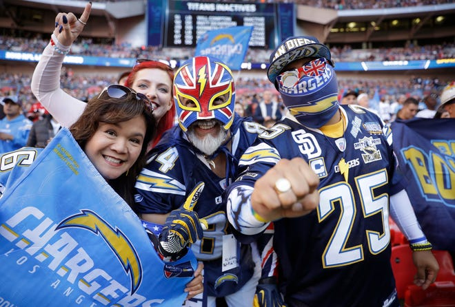 Los Angeles Chargers fans react before an NFL football game against Tennessee Titans at Wembley stadium in London, Sunday, Oct. 21, 2018. (AP Photo/Matt Dunham)