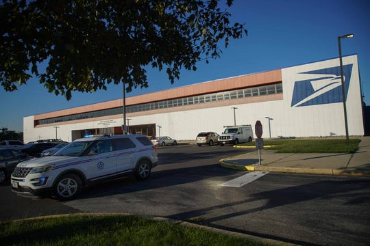 Postal Police remained outside of the U.S. Post Service Delaware Processing and Distribution Center in New Castle off Quigley Blvd. on Thursday morning after law enforcement investigated another suspicious package potentially targeting former Vice President Joe Biden.