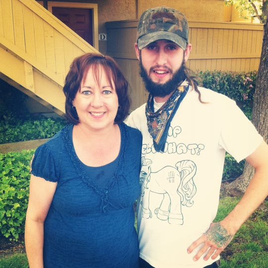 Joel Davis, pictured here with his mother, Jill. She died in 2013.