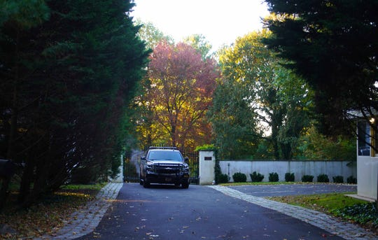 A single police vehicle sits outside the gates to former Vice President Joe Biden's Greenville home after another suspicious package was reported at the U.S. Postal office in New Castle off Quigley Blvd.