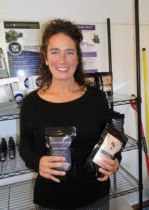 Rebecca Burgmeier processes products in a licensed kitchen and markets the healthy aronia berries in her own on-farm store and at numerous other locations. She also holds classes at her farm store to help people understand nutrition and health.