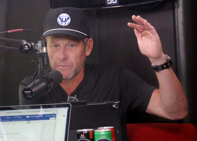 Lance Armstrong talks on his Tour de France podcast in July.