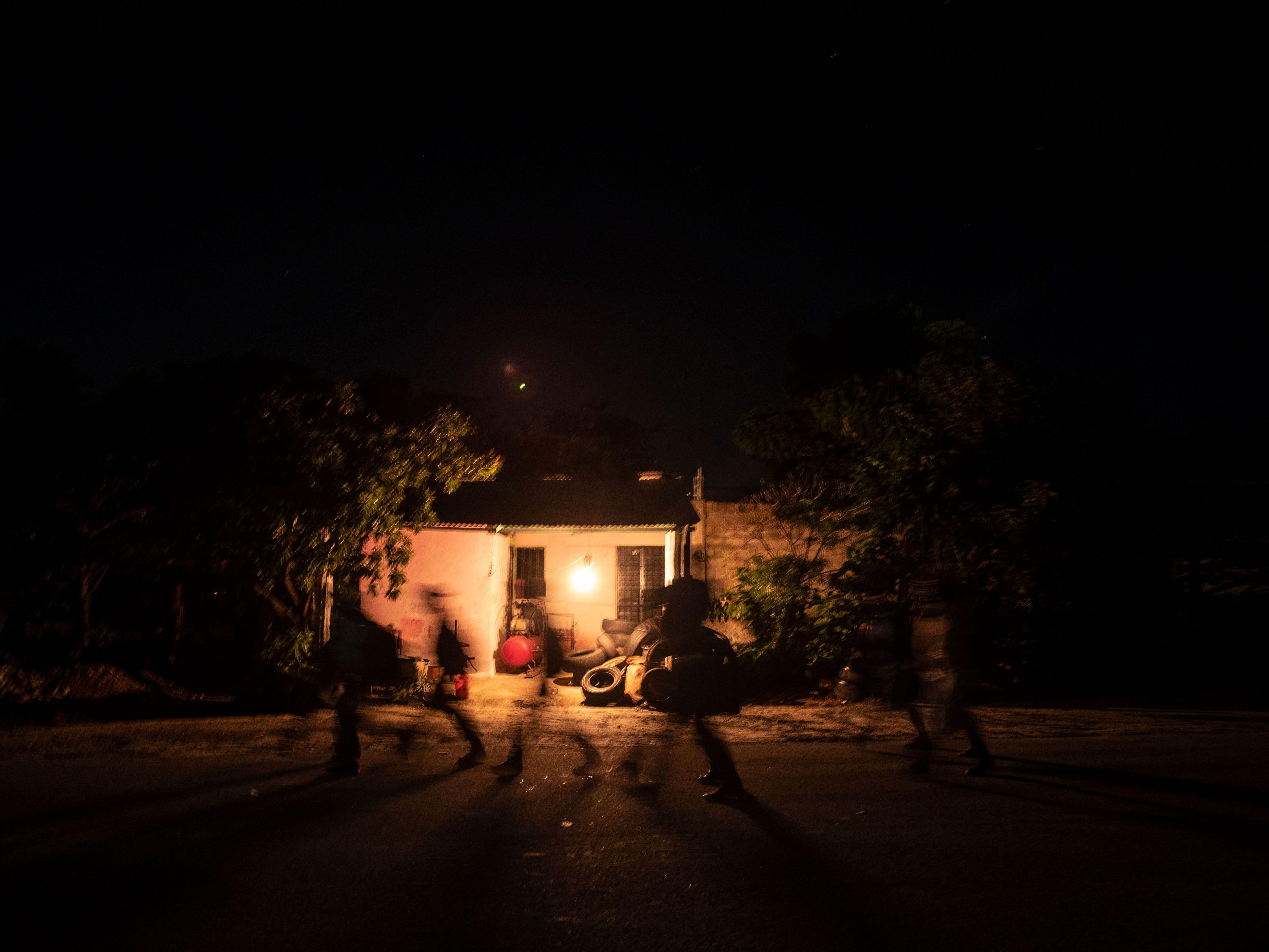Central American migrants walk near Mapastepec, southern Mexico, Oct. 25, 2018.