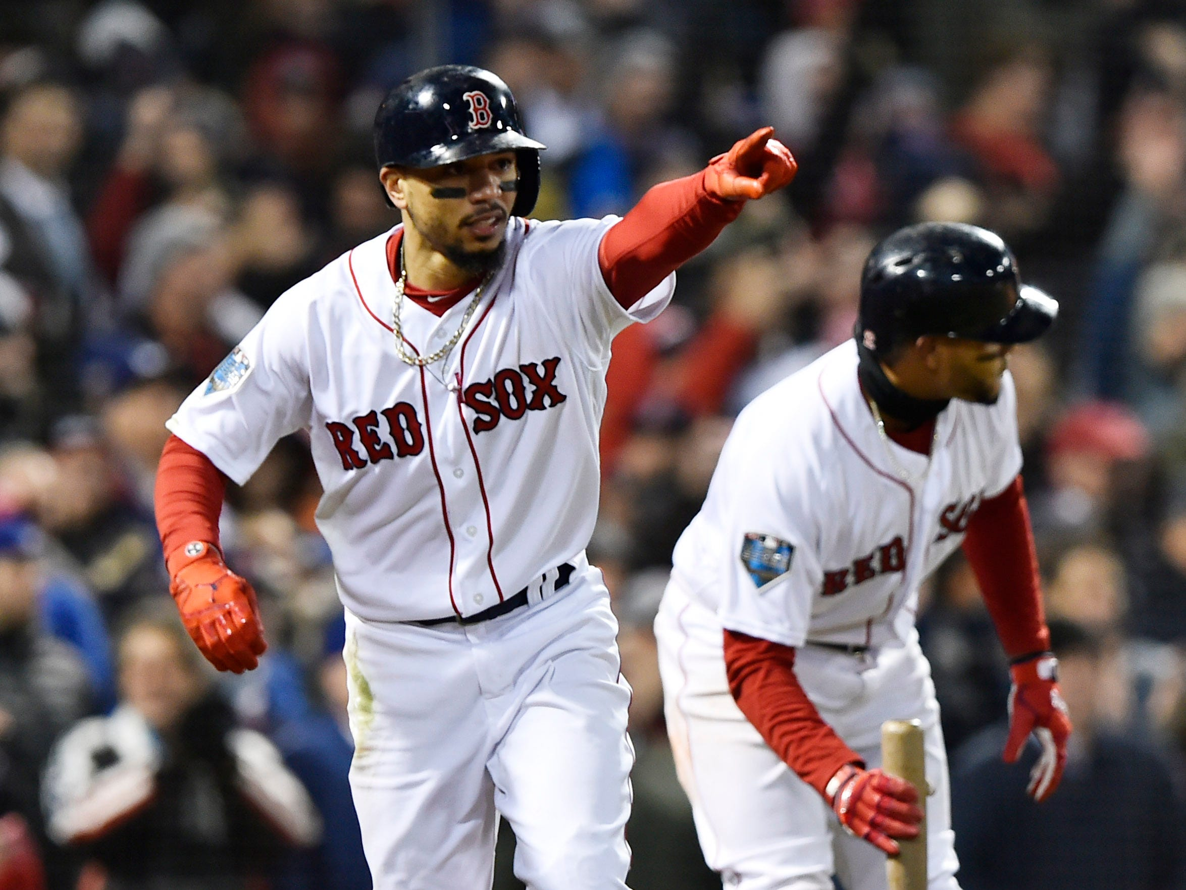 Game 2 at Fenway Park: Mookie Betts reacts after scoring in the fifth inning.