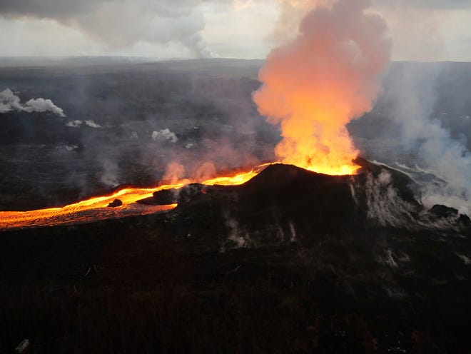 In this July 14, 2018 photo provided by the U.S. Geological Survey, lava from Kilauea volcano erupts in the Leilani Estates neighborhood near Pahoa, Hawaii.