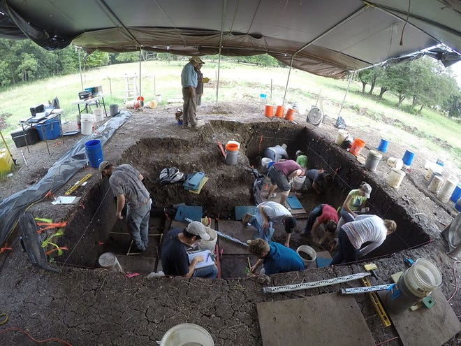Researchers at Texas A&M University excavate a site in central Texas.