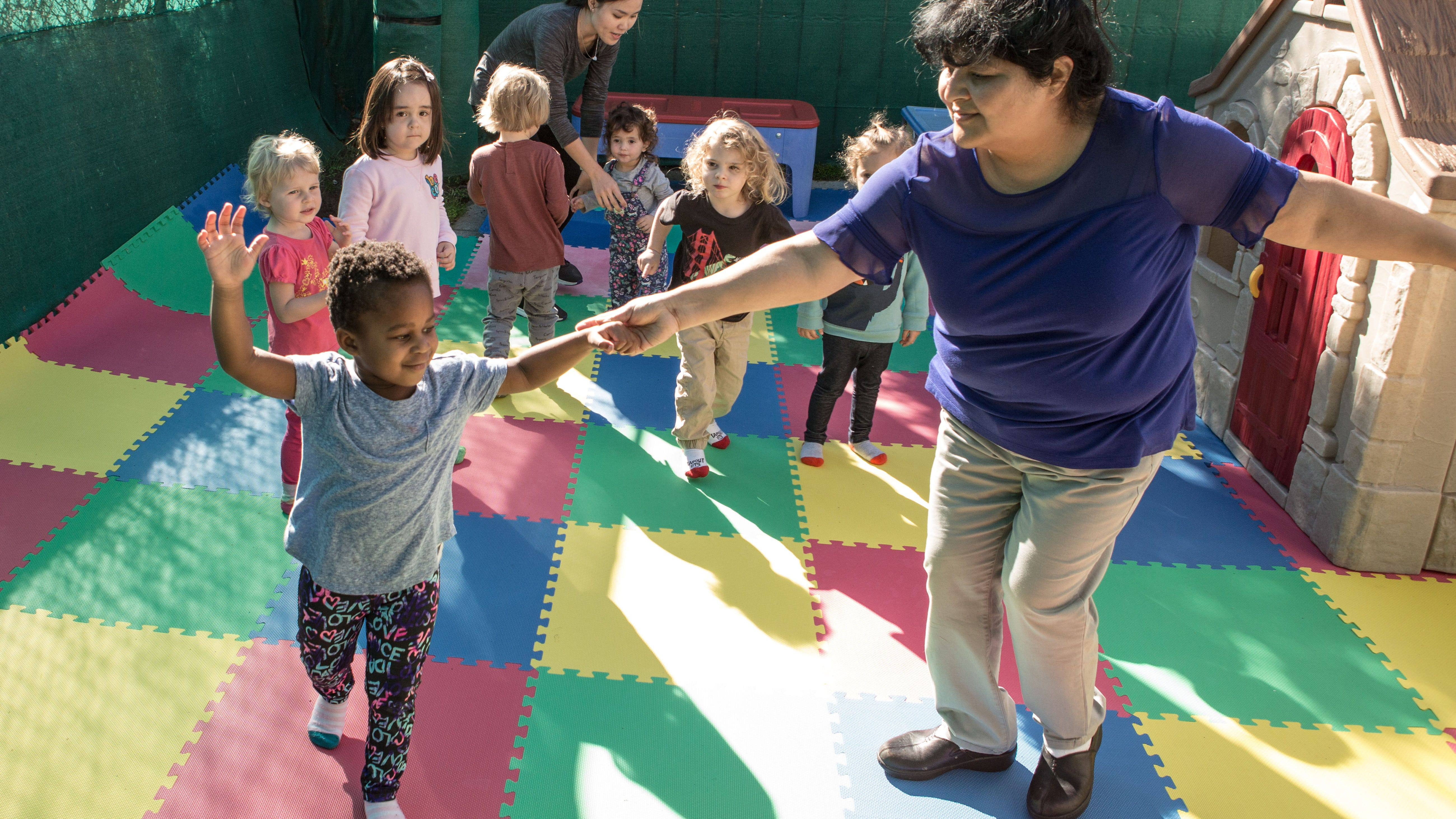 Zonia Torres, childcare provider and educator dances with preschoolers at Shining Stars Family Child Care in San Francisco on Oct. 24, 2018. Shining Stars Family Child Care in San Francisco is part of an obesity prevention program that uses research-backed approaches (like serving lots of fruits and vegetables and getting kids active for 2 hours a day Ð in her case, with salsa and merengueÊdancing, as well as backyard play).