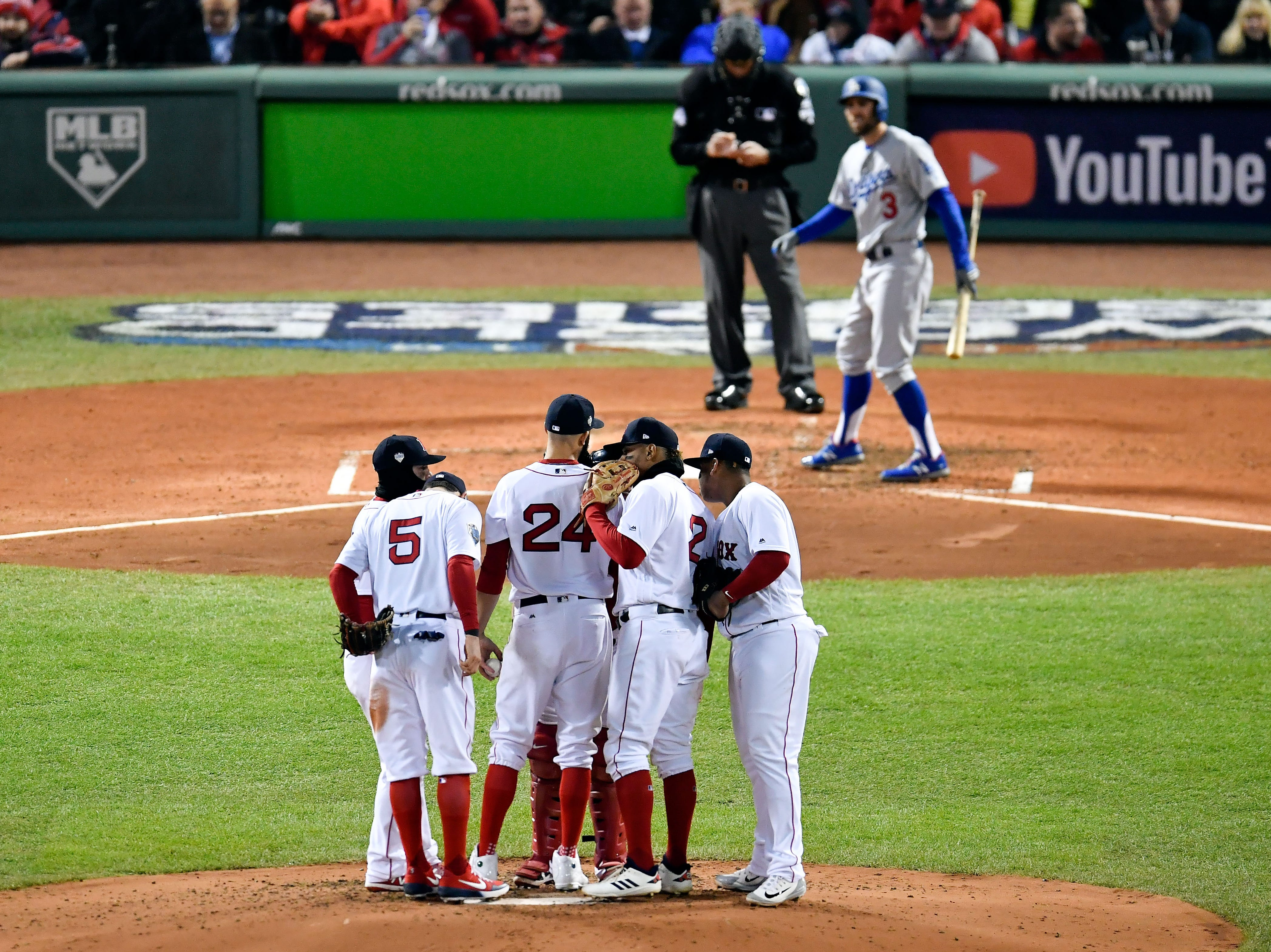 Game 2 at Fenway Park: Red Sox players huddle at the mound with pitcher David Price in the fourth inning.