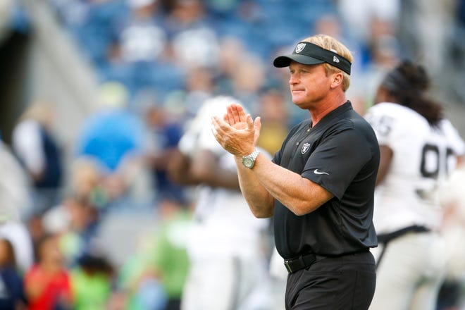 Oakland Raiders head coach Jon Gruden watches pregame warmups against the Seattle Seahawks at CenturyLink Field.