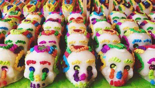 Sugar skulls are iconic symbols of Dia de los Muertos, Day of the Dead, celebrations. They are made of compressed sugar and have metallic sequins for eyes and colorful icing for hair.