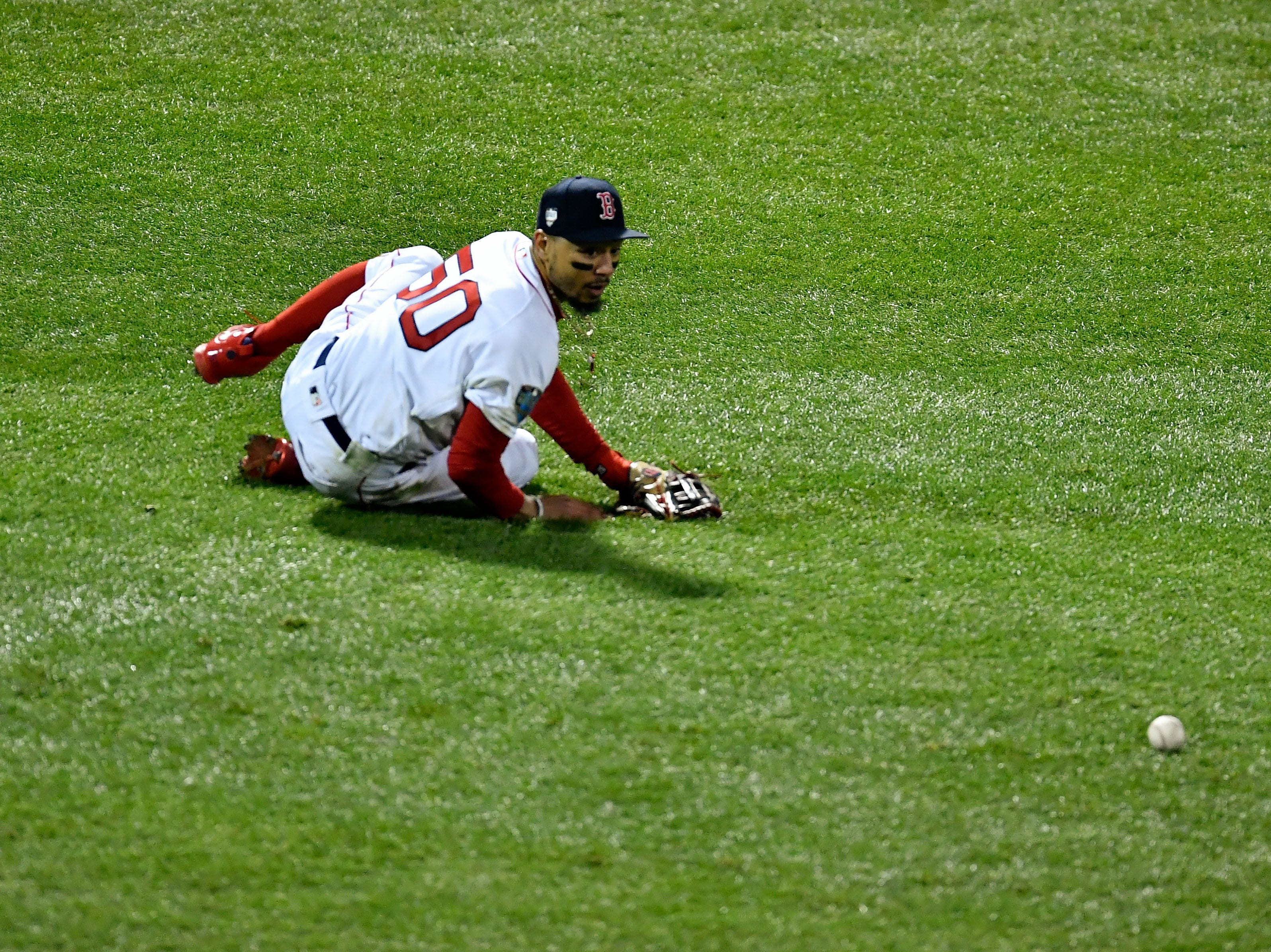 Game 2 at Fenway Park: Red Sox right fielder Mookie Betts reacts after David Freese hit a single in the fourth.