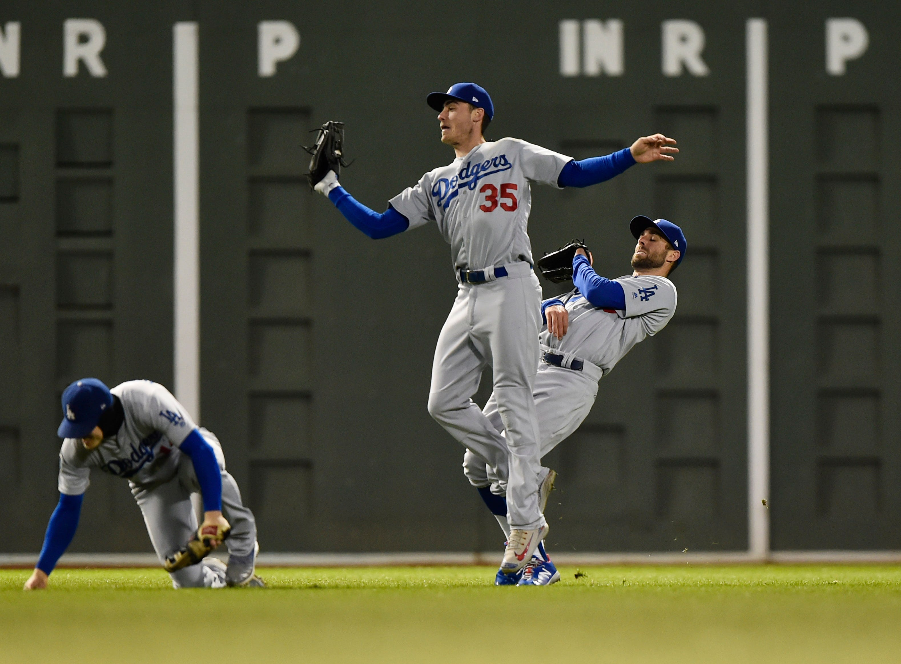 Game 2 at Fenway Park: Dodgers outfielder Cody Bellinger makes a catch while avoiding teammates in the sixth.