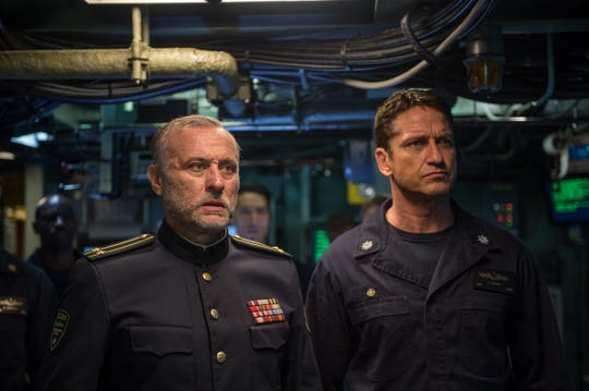 Not a typical day in the Navy: Russian Captain Andropov (played by Michael Nyqvist) and U.S. Captain Joe Glass (Gerald Butler) aboard the USS Arkansas.
