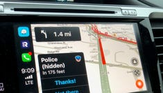 Notifications pop up in Waze to warn you of potholes or hidden police.