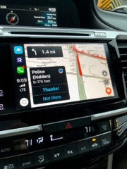 Notifications pop up in Waze to warn you of potholes or hidden police.