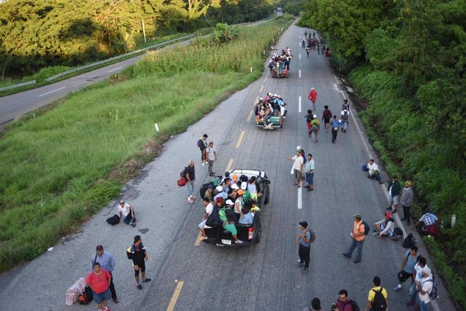 Central American migrants take part in a caravan toward the U.S., traveling on foot or atop vehicles in Mapastepec on their way to Pijijiapan Chiapas state, Mexico, Oct. 25, 2018.