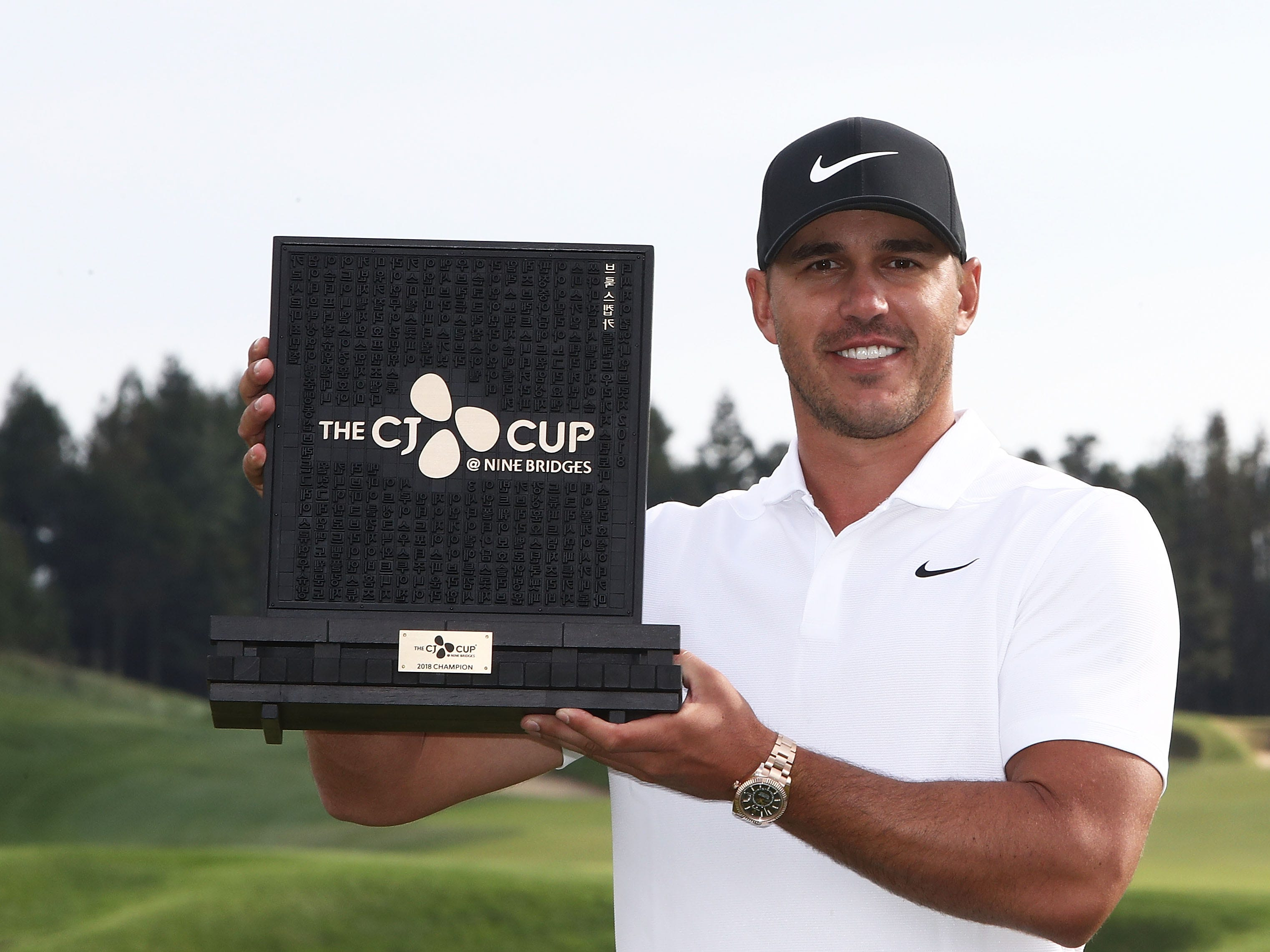 Oct. 21: Brooks Koepka poses with the trophy after winning the CJ Cup at the Nine Bridges in Jeju, South Korea.