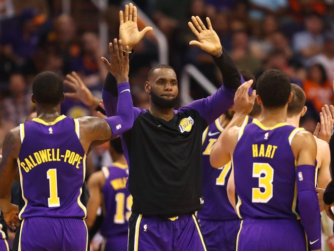 Lebron James led seven Lakers in double figures.