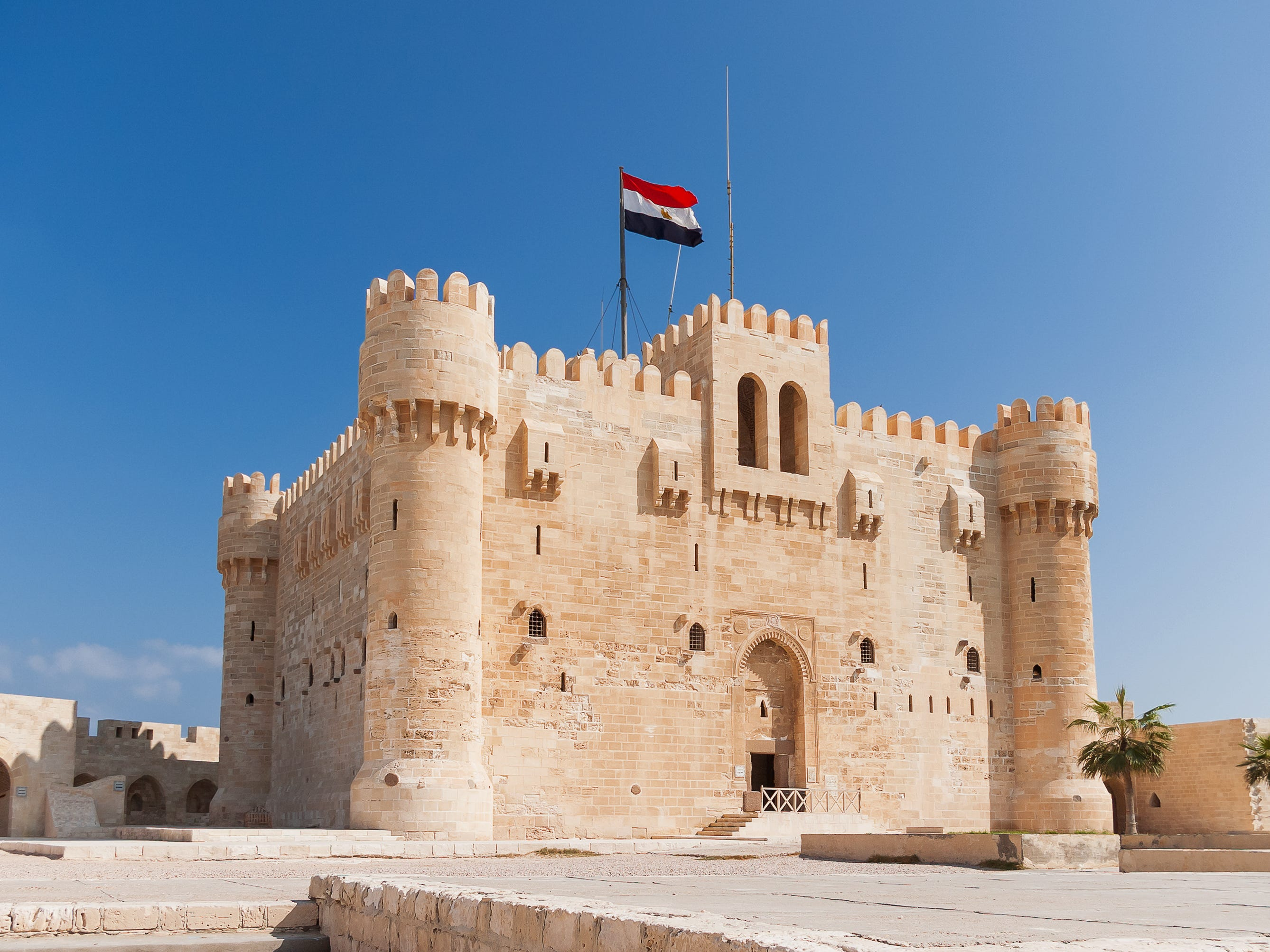 Citadel of Qaitbay in Alexandria, Egypt: On the other side of the Mediterranean, the Citadel of Qaitbay is a sand-colored medieval fortress that was built in the 14th century to withstand attacks from the Ottoman Empire.