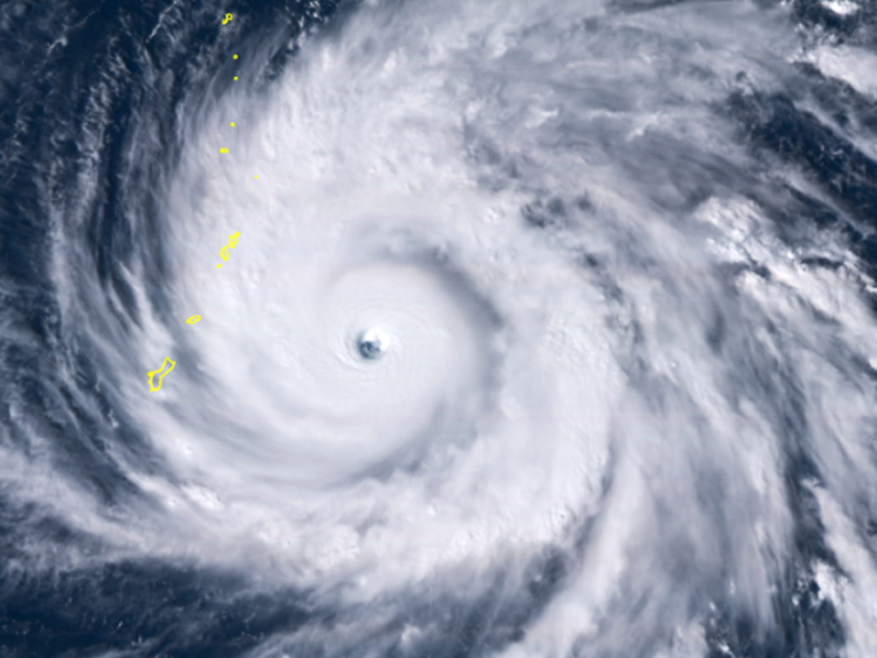 This satellite image provided by the National Oceanic and Atmospheric Administration (NOAA) shows Typhoon Yutu east of Guam Wednesday afternoon, Oct. 24, 2018 local time. The storm crossed over the U.S. Commonwealth of the Northern Mariana Islands, producing damaging winds and high surf. The National Weather Service in Honolulu says maximum sustained winds of 180 mph (290 kph) were recorded around the eye of the storm, which passed over Tinian island and Saipan early Thursday morning local time. Waves of 25 to 40 feet (6 to 12 meters) are expected around the eye of the storm.