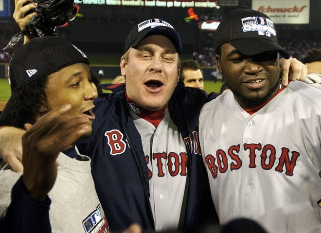Red Sox players, from left,  Pedro Martinez, Curt Schilling and David Ortiz celebrate after the Red Sox defeated the Cardinals 3-0 in Game 4 to win the 2004 World Series.