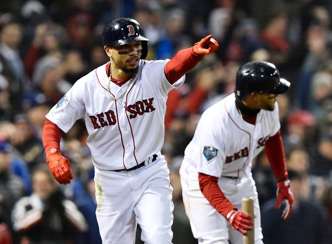Red Sox outfielder Mookie Betts reacts after scoring in the fifth inning.