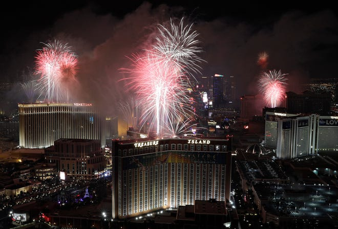 Fireworks explode over the Las Vegas Strip during a New Year's Eve celebration on Jan. 1, 2017, in Las Vegas.