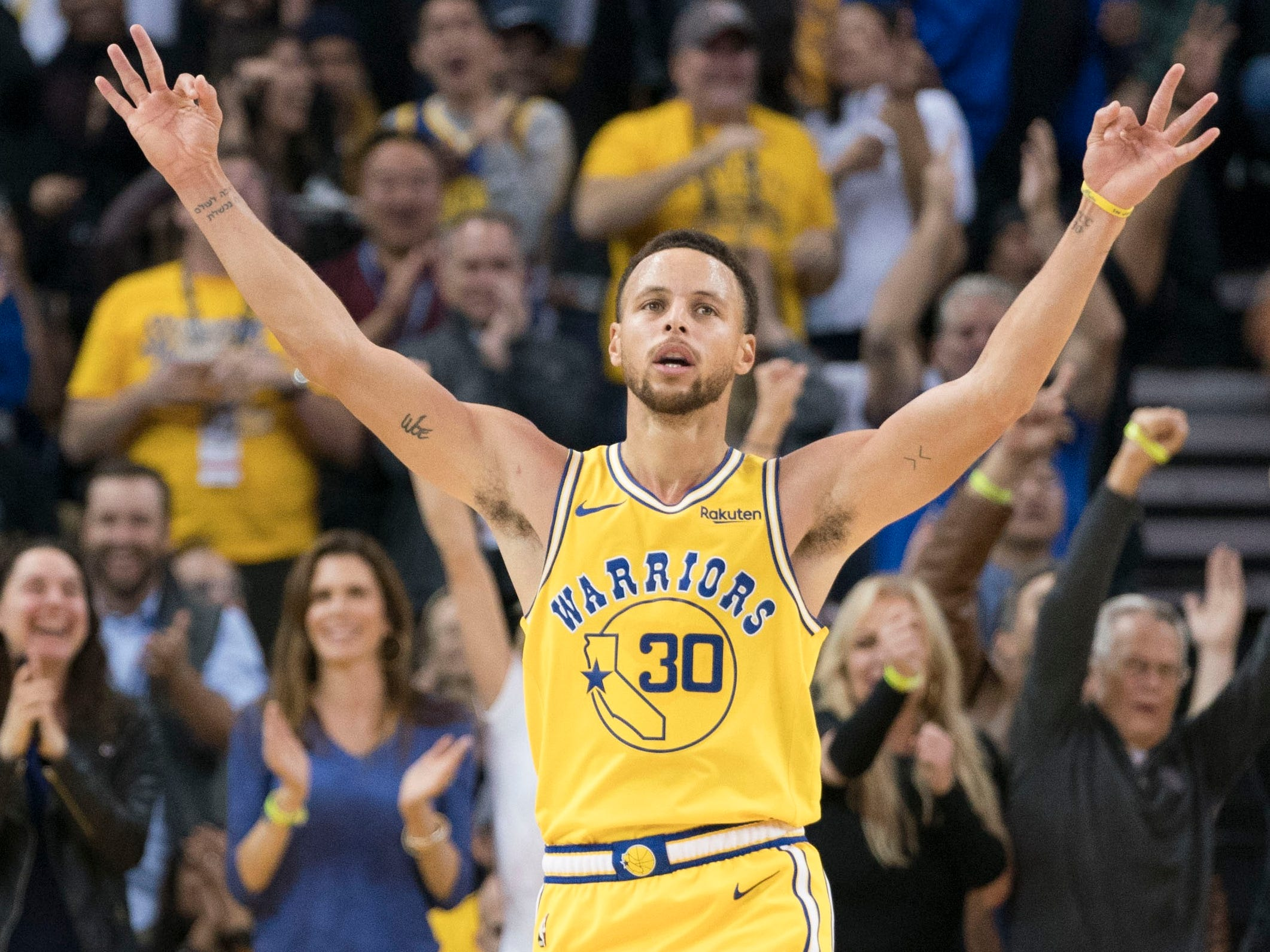 Oct. 24: Warriors guard Steph Curry celebrates after sinking one of his 11 3-pointers in a 51-point effort against the Wizards.